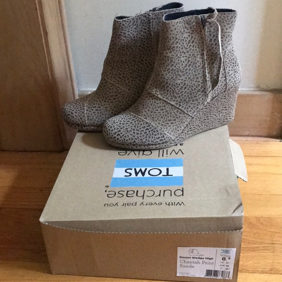 287bd9345aa Toms Desert Wedge High cheetah booties. M 5b38fec89519969fde04dcce
